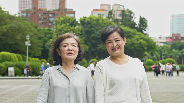 "retired chinese female friends walking in public park - xavierarnau or ""xavier arnau serrat"" stock videos & royalty-free footage"