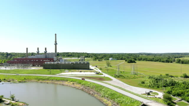 retired coal burning and propane power plant in missouri mid west usa 4k drone video - power station stock videos & royalty-free footage