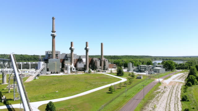 retired coal burning and propane power plant in missouri mid west usa 4k drone video - midwest usa stock videos & royalty-free footage