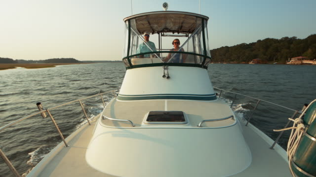 retired couple boating together - jet boating stock videos & royalty-free footage