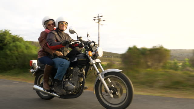retired couple on a motorbike trip together on a country road. - motorbike stock videos & royalty-free footage