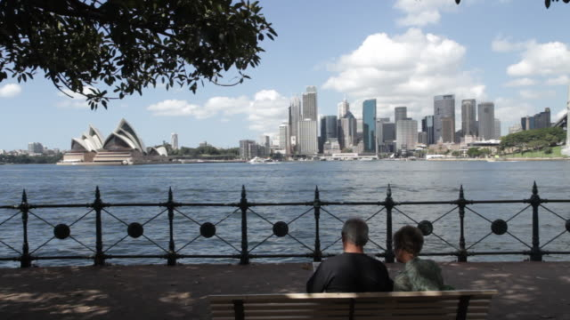 Retired Couple seated by Sydney harbour