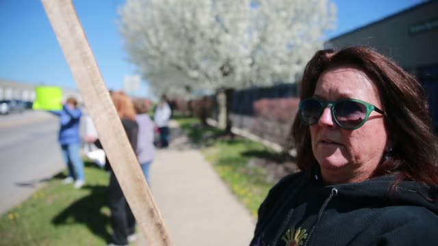 retired general electric refrigerator factory workers protest near the bloomington factory about the loss of their retiree health benefits due to... - general electric stock videos & royalty-free footage