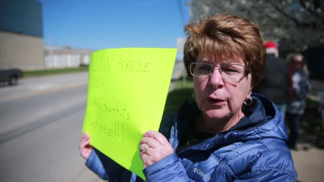 retired general electric refrigerator factory workers protest near the bloomington factory about the loss of their retiree health benefits due to... - general electric stock videos and b-roll footage