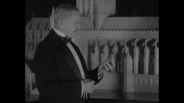 sot retired general of the armies of the us john j pershing wearing black tie and tuxedo stands in front of a diorama of the underconstruction... - george washington stock videos and b-roll footage
