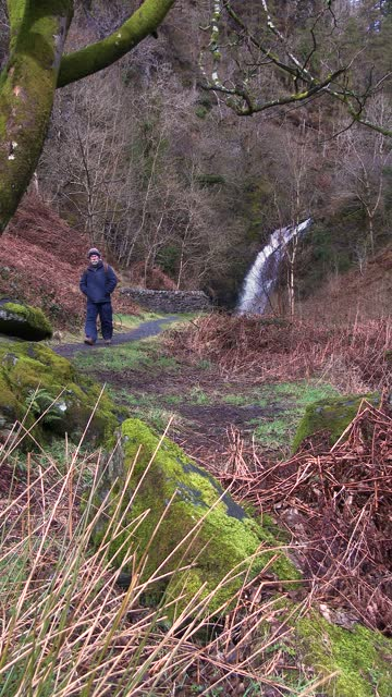 retired man walking away from a waterfall - johnfscott stock videos & royalty-free footage
