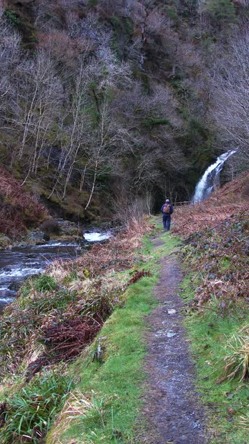 retired man walking on a path beside a river - johnfscott stock videos & royalty-free footage