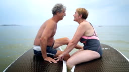 Retired senior couple enjoying on the sea