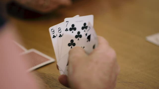 retired seniors playing a game of cards - hand of cards stock videos & royalty-free footage