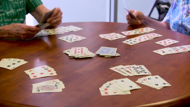 retired seniors playing cards - gambling stock videos & royalty-free footage