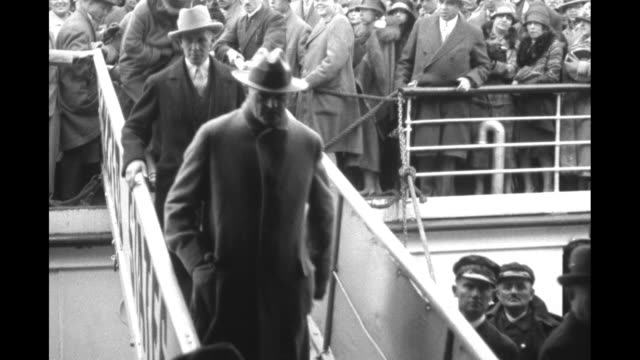 retired us general john pershing wearing civilian clothing walks down the gangplank of an ocean liner as he arrives in cherbourg / cu his face - normandie stock-videos und b-roll-filmmaterial