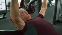 Retiree Doing Bench Press