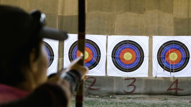 retirement activity shooting a bow - archery bow stock videos and b-roll footage