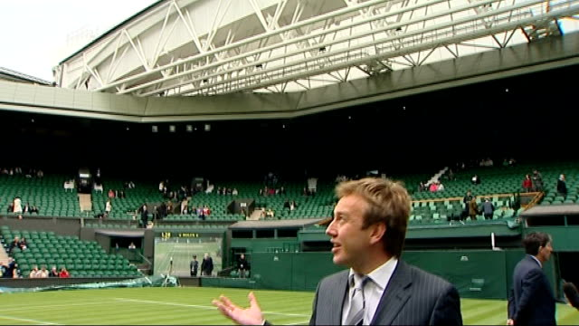 retractable roof unveiled at wimbledon's centre court; england: london: wimbledon: all england club: ext tennis fans walking through wimbledon tennis... - roof stock videos & royalty-free footage