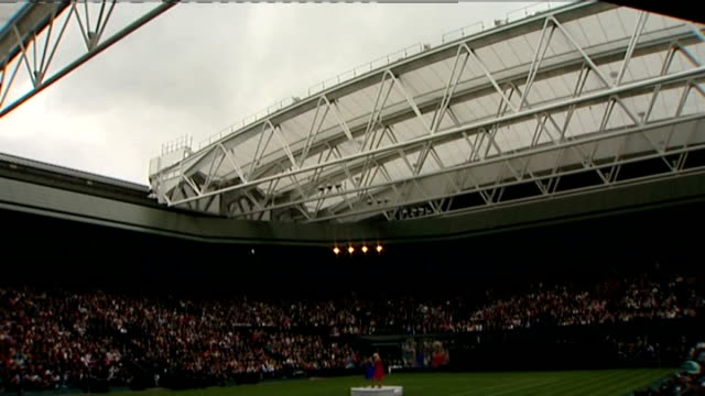 retractable roof unveiled at wimbledon's centre court; england: london: wimbledon: all england club: ext speeded up sequence retractable roof of... - international tennis federation stock videos & royalty-free footage