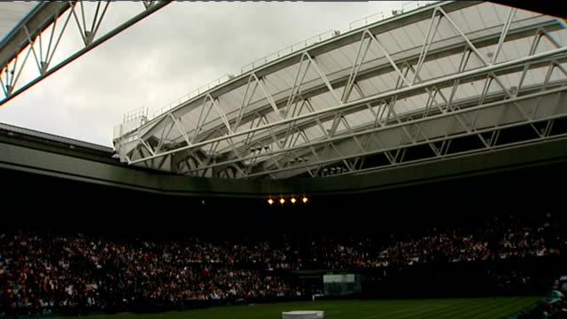 retractable roof unveiled at wimbledon's centre court more of roof slowly closing over centre court - roof stock videos & royalty-free footage