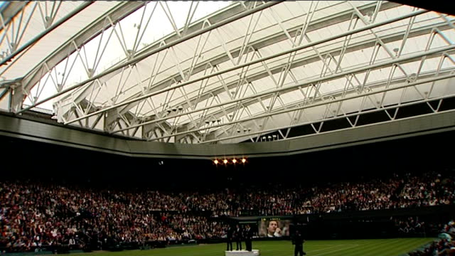 retractable roof unveiled at wimbledon's centre court; roof in closed position, male opera singers perform song from centre of court sot - roof stock videos & royalty-free footage