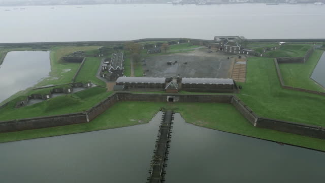 retreating aerial shot showing the striking, angular tilbury fort on the thames estuary, uk. - estuary stock videos & royalty-free footage