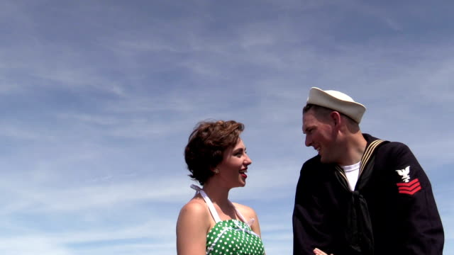 retro 50s girl flirts with sailor - sailor suit stock videos and b-roll footage