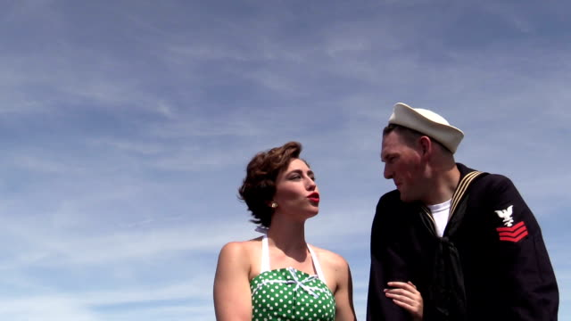 retro 50s girl flirts with sailor - polka dot stock videos and b-roll footage