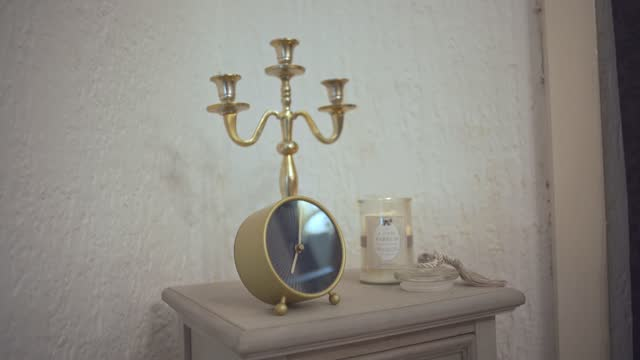 retro candlestick holder with a minimalistic alarm clock on a nightstand - antique stock videos & royalty-free footage
