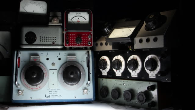 retro dials and gauges coming to life in a boffin's den - surveillance stock videos and b-roll footage