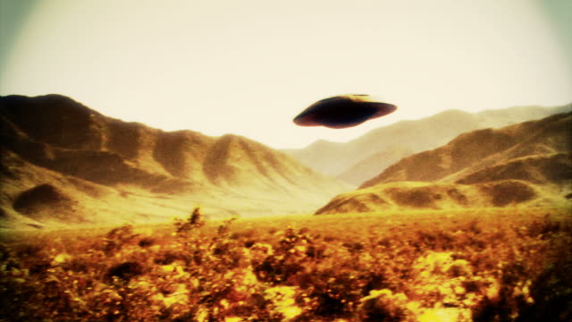 Retro footage of a UFO flying saucer in the desert.