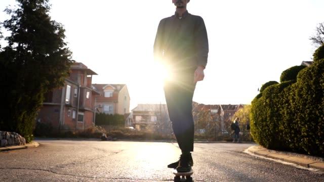 retro like skater enjoying a sunny spring day - longboarding stock videos & royalty-free footage