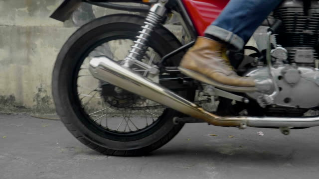 retro moto rider's boots - motorcycle racing stock videos and b-roll footage