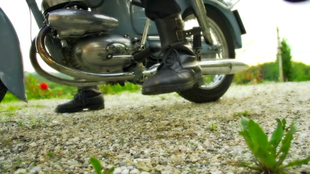 hd slow motion: retro moto rider's boots - boot stock videos & royalty-free footage