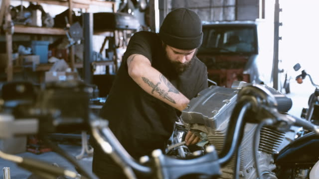 retro motorcycle mechanic - stereotypically working class stock videos & royalty-free footage
