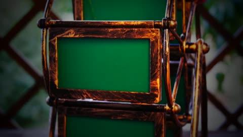 vídeos y material grabado en eventos de stock de álbum de fotos retro girando sobre fondo anticuado - transferencia de impresión instantánea