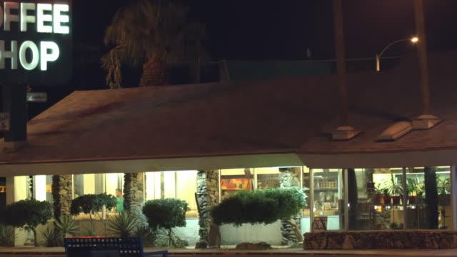 WS PAN retro style coffee shop diner at night / Blythe,California, USA