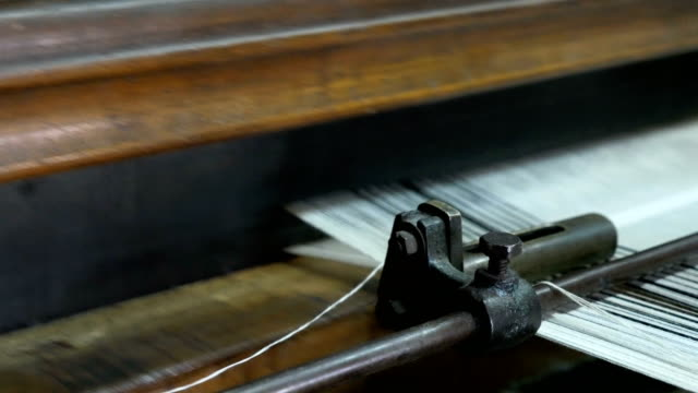 retro style threads on a loom in weaving machine - loom stock videos & royalty-free footage