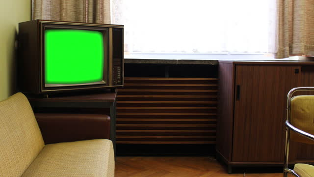 retro television in a vintage living room with chroma key screen - living room stock videos & royalty-free footage