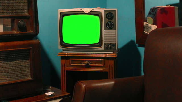 retro television in vintage living room with chroma key screen - living room stock videos & royalty-free footage