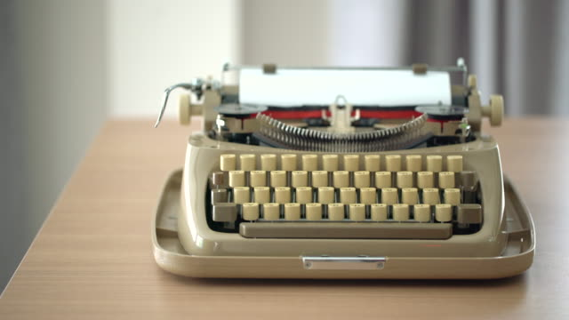 4k retro & vintage style typewriter in studio with dolly - author stock videos & royalty-free footage