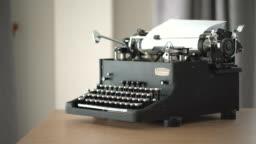 4K Retro & vintage style typewriter in studio with dolly