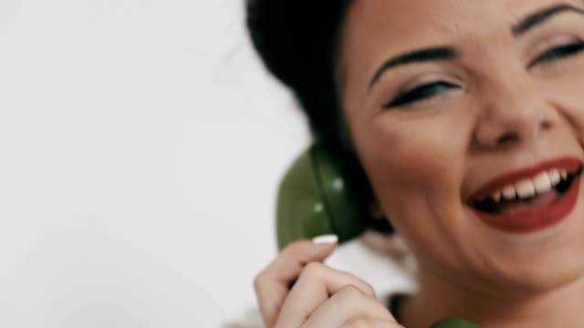 retro woman on the phone - rotary phone stock videos and b-roll footage