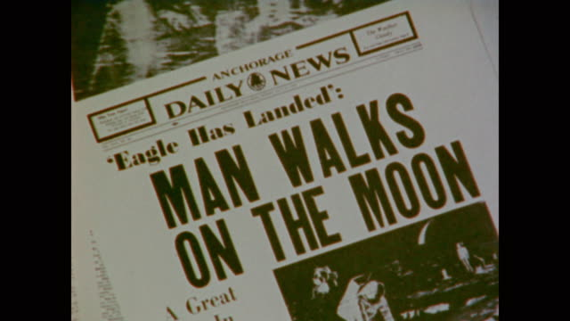 a retrospective view of the moon landing in social context - mond stock-videos und b-roll-filmmaterial