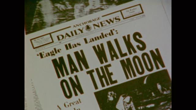 retrospective view of the moon landing in social context - mond stock-videos und b-roll-filmmaterial