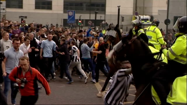 return of football hooliganism 14413 newcastle central station mounted police trying to control rioting fans after newcastle united vs sunderland... - punching stock videos & royalty-free footage