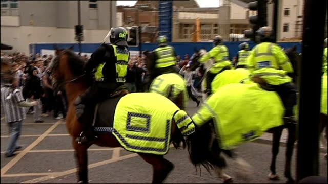 return of football hooliganism lib newcastleupontyne ext newcastle united fans surging towards mounted police officers man covering mouth with scarf... - neckwear stock videos and b-roll footage