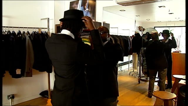 'return of the rudeboy' exhibition at somerset house; ext reporter along int shirt and tie on mannequin in clothes shop sequence charlie allen... - shirt and tie stock videos & royalty-free footage