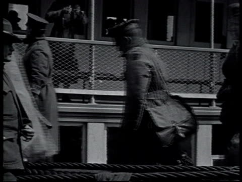 vidéos et rushes de returned wwi veterans in line to enter a building carrying bags / new york city new york united states - 1910 1919