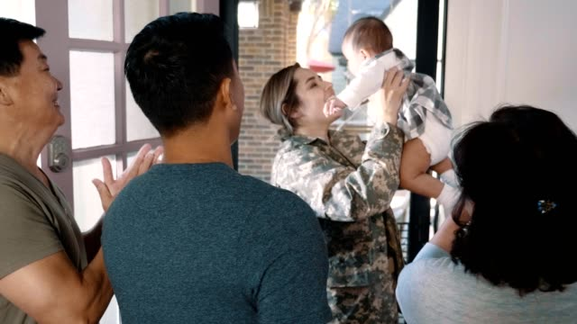 returning female soldier greets excited family - army stock videos & royalty-free footage