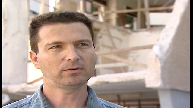 returning israeli soldiers criticise military resources haifa ext wreckage of damaged buidling unidentified former police officer talking to rogers... - haifa stock videos and b-roll footage