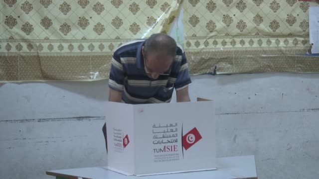 returning officers begin to count the votes following the end of the polling for the presidential elections at rue de russie school in tunis, tunisia... - candidate stock videos & royalty-free footage