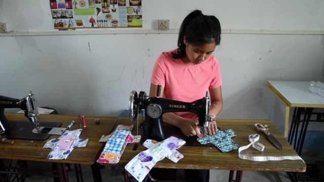 vídeos de stock, filmes e b-roll de reusable cloth sanitary napkins are seen made by underprivileged woman - feminidade
