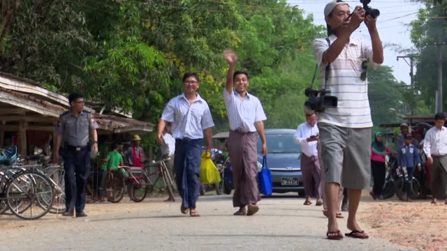 reuters journalists wa lone and kyaw soe oo freed from prison in yangon jailed for their reporting on the rohingya crisis in myanmar - reuters stock videos & royalty-free footage